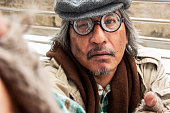 istock Unhappy lifestyle Homeless senior man on walkway street in capital city. 1331483434