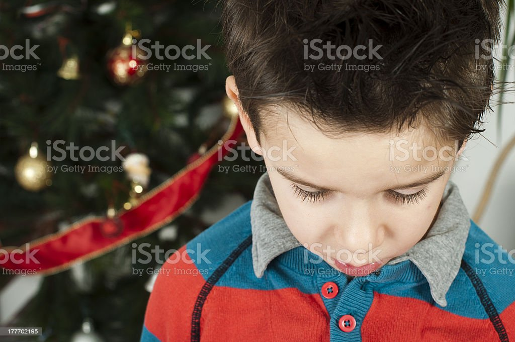Unhappy little boy on christmass royalty-free stock photo