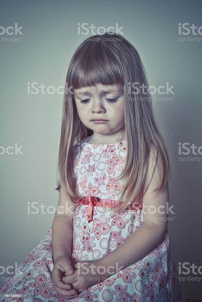 Unhappy little girl royalty-free stock photo