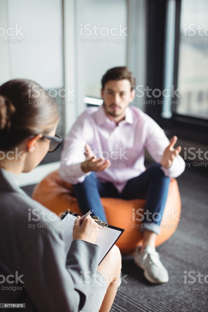 Unhappy man consulting counselor royalty-free stock photo