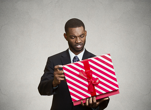 istock Unhappy man, displeased with new gift 492007344