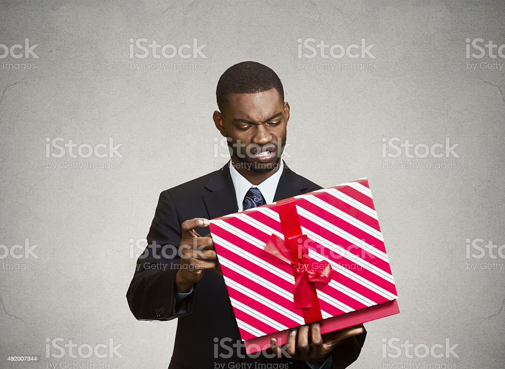 Unhappy man, displeased with new gift stock photo