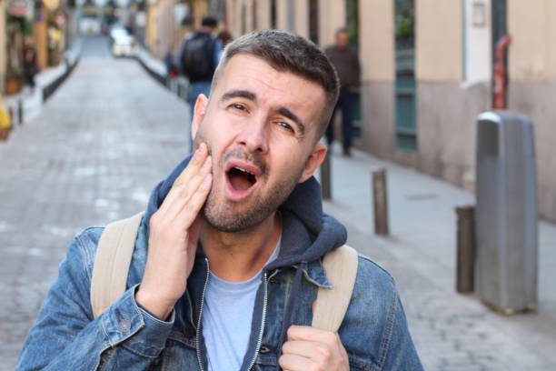 Unhappy man suffering from bruxism Unhappy man suffering from bruxism. clenching teeth stock pictures, royalty-free photos & images
