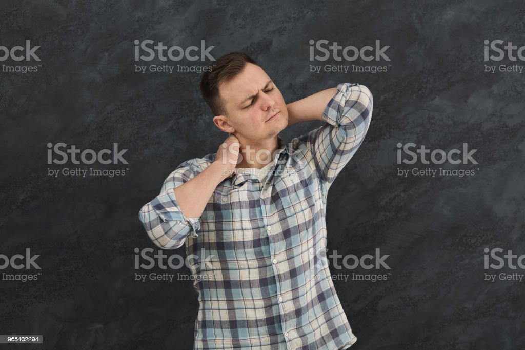 Unhappy man suffering from neck or shoulder pain royalty-free stock photo