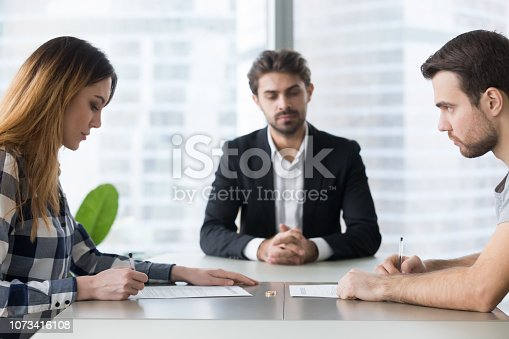 istock Unhappy married family young couple getting divorced 1073416108