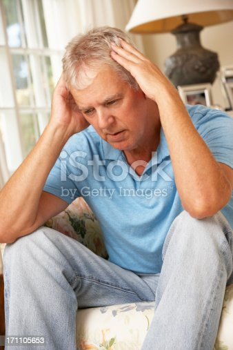 istock Unhappy Mature Man Sitting On Sofa At Home 171105653