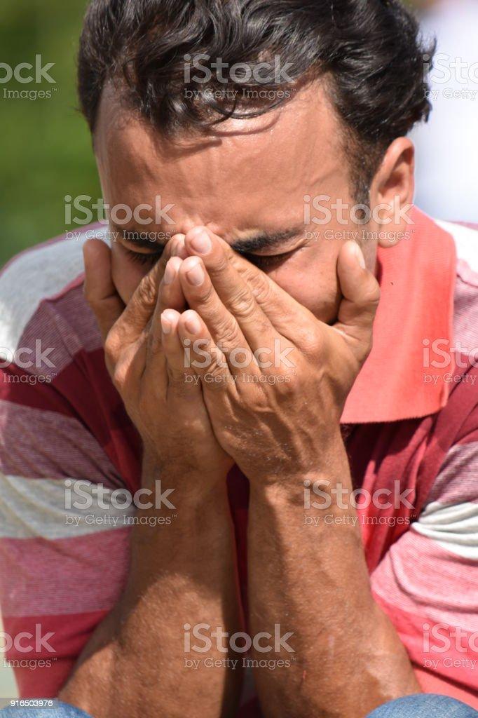 Unhappy Minority Male stock photo