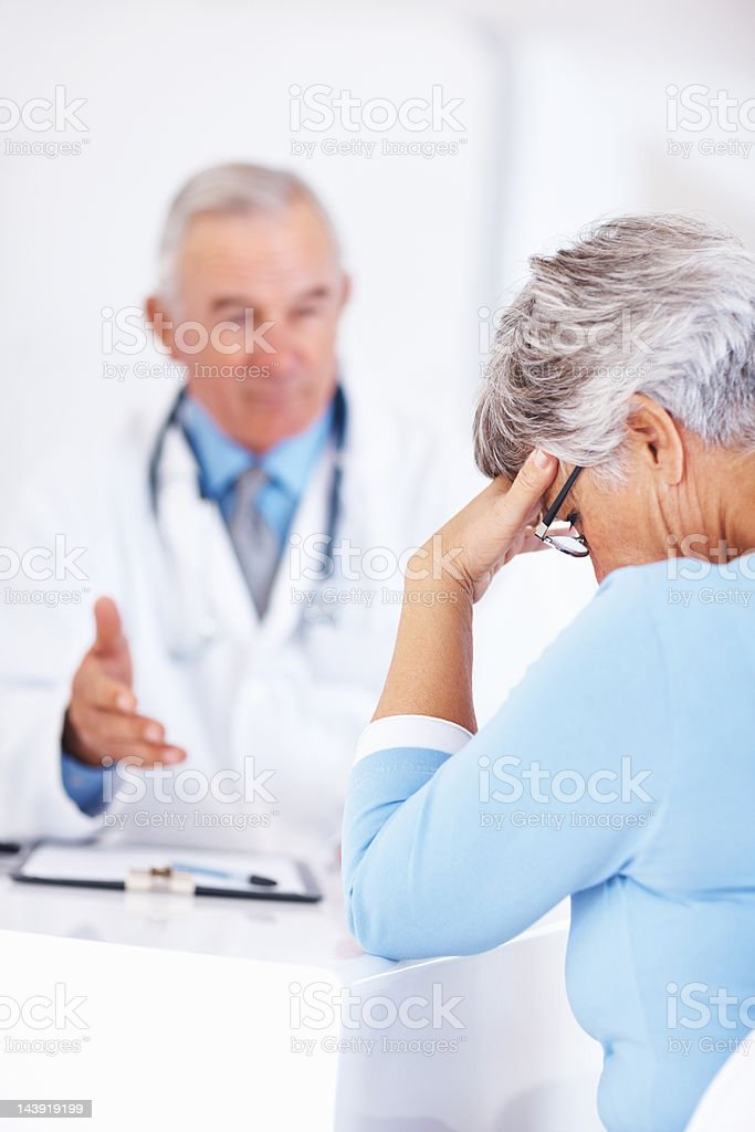 Unhappy patient with doctor royalty-free stock photo