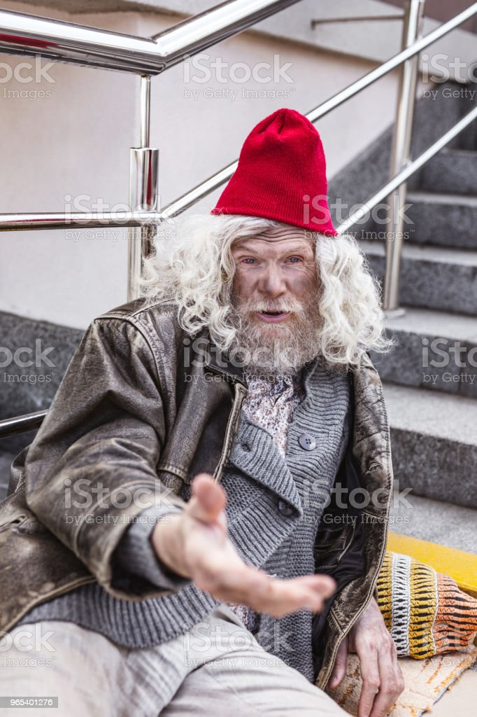 Unhappy poor man begging for money royalty-free stock photo