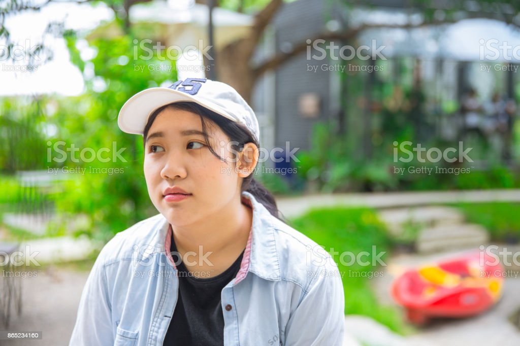 unhappy portrait cute young innocent asian teen expression boring stock photo