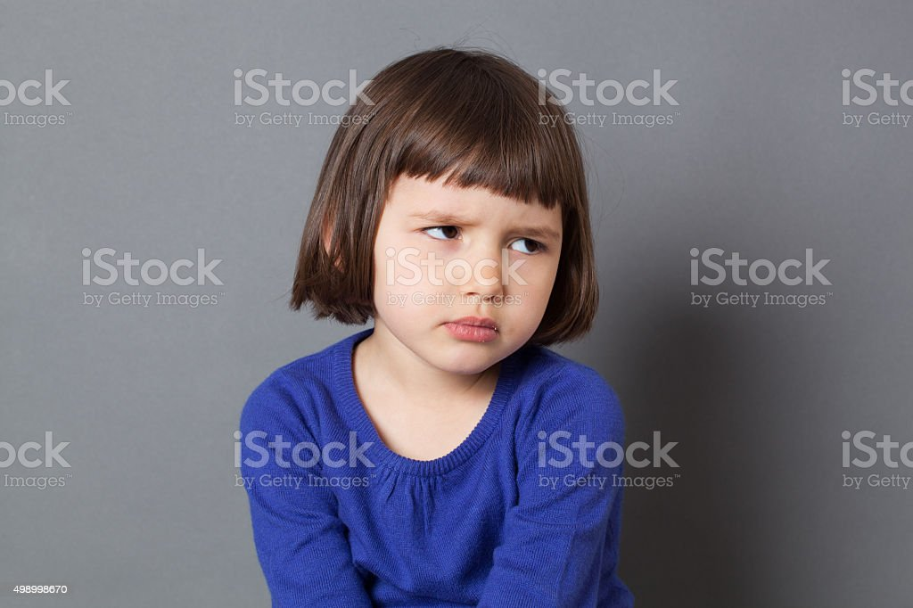 unhappy preschooler with dirty look expressing disappointment or frustration royalty-free stock photo