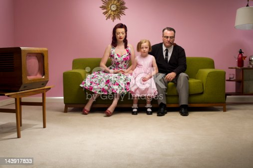1950s family stare at the floor