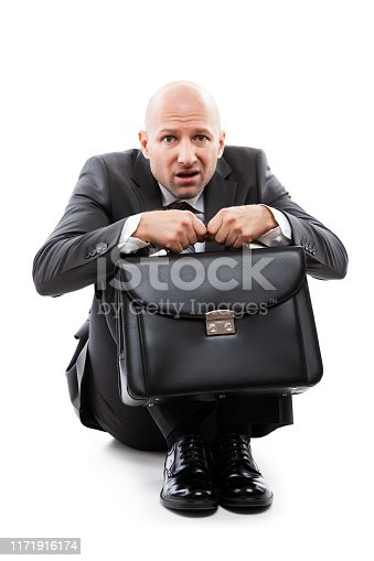 1162960006istockphoto Unhappy scared or terrified businessman in depression hand holding briefcase 1171916174