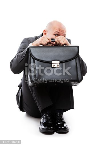 1162960006istockphoto Unhappy scared or terrified businessman in depression hand holding briefcase 1171916206