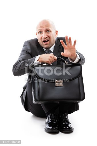 1162960006istockphoto Unhappy scared or terrified businessman in depression hand holding briefcase 1171916228