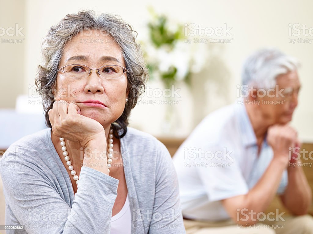 unhappy senior asian couple stock photo