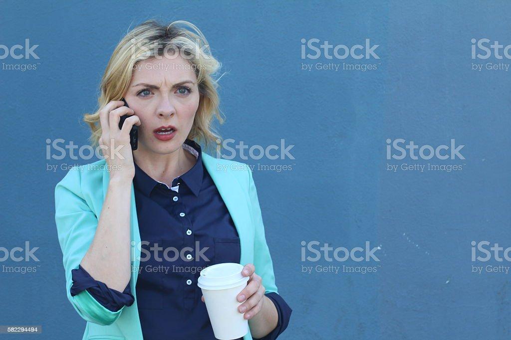 Unhappy serious woman talking on phone stock photo