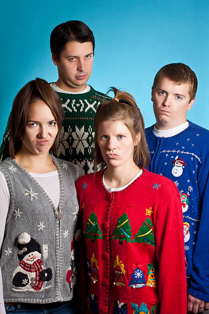unhappy sweater group - ugly sweater stock photos and pictures