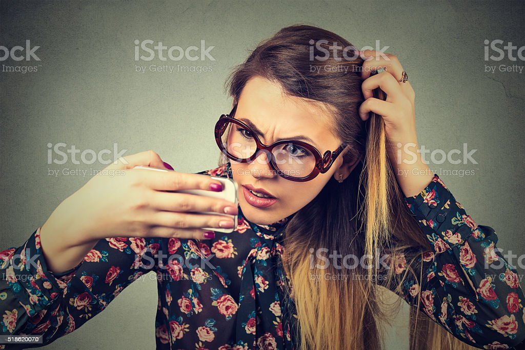 unhappy upset young woman surprised she is losing hair stock photo