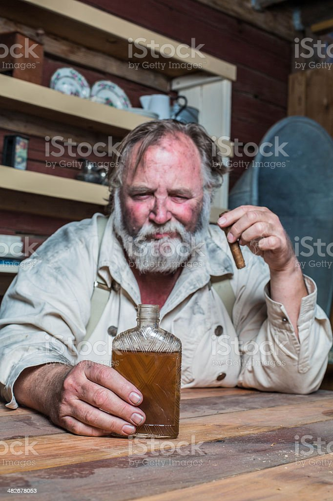 Unhappy Western Man at Table stock photo