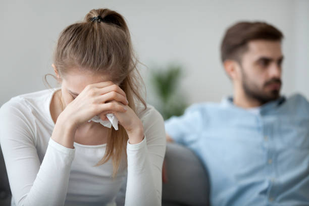 Unhappy wife tired of bad relationships, worried about problems concept Depressed frustrated millennial woman feeling offended and sad after fight with stubborn selfish husband, unhappy young wife tired of bad relationships, worried about marriage problems concept abortion stock pictures, royalty-free photos & images