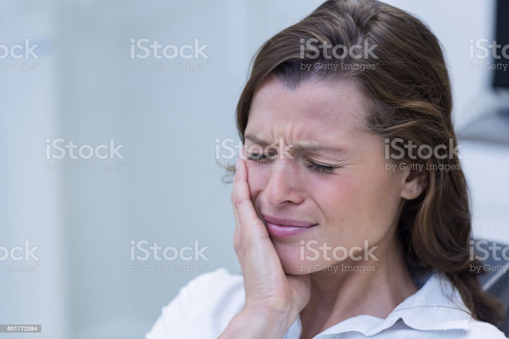 Unhappy woman having a toothache stock photo