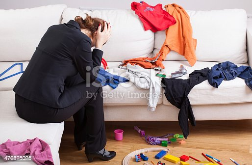 istock Unhappy woman in mess 476825025
