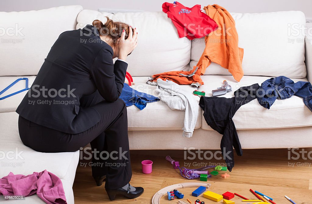 Unhappy woman in mess stock photo