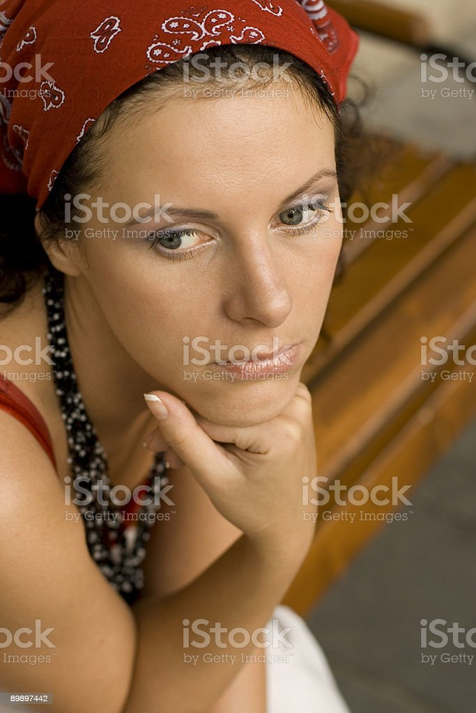 unhappy woman in red kerchief royalty-free stock photo