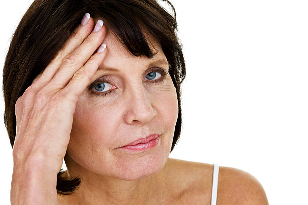 unhappy woman - mature woman fever on white bildbanksfoton och bilder