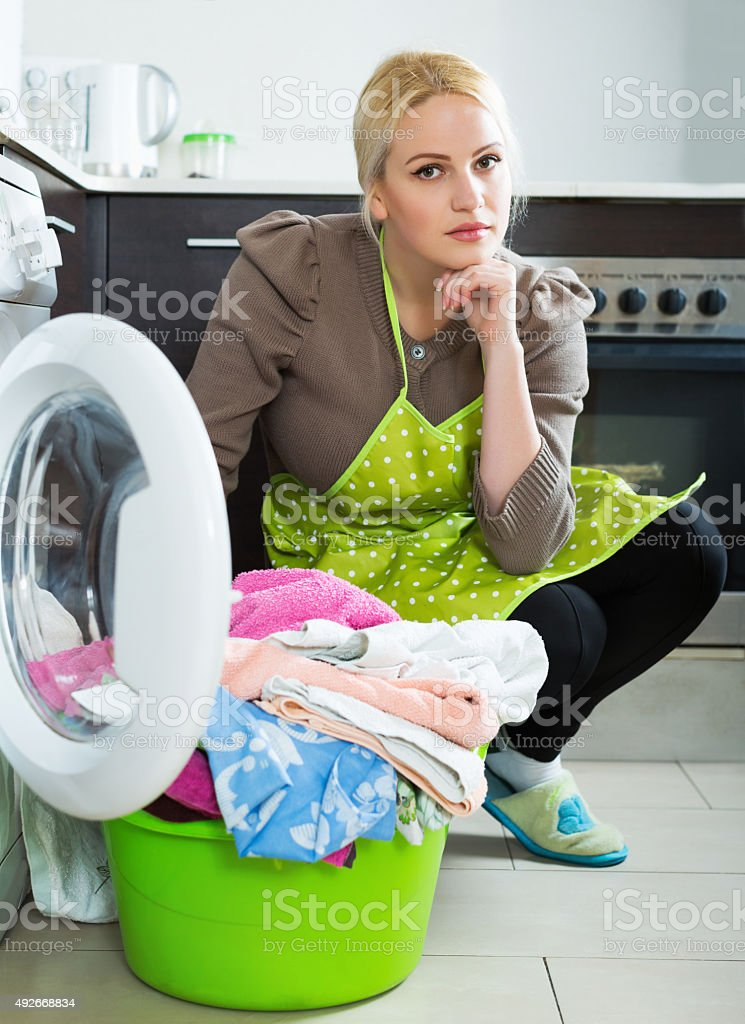 Unhappy woman with clothes stock photo
