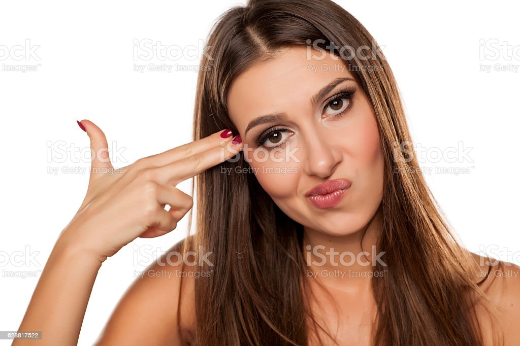 unhappy woman with fingers like a gun stock photo