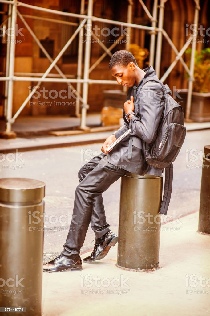 Unhappy Young African American College Student thinking on street in New York photo libre de droits