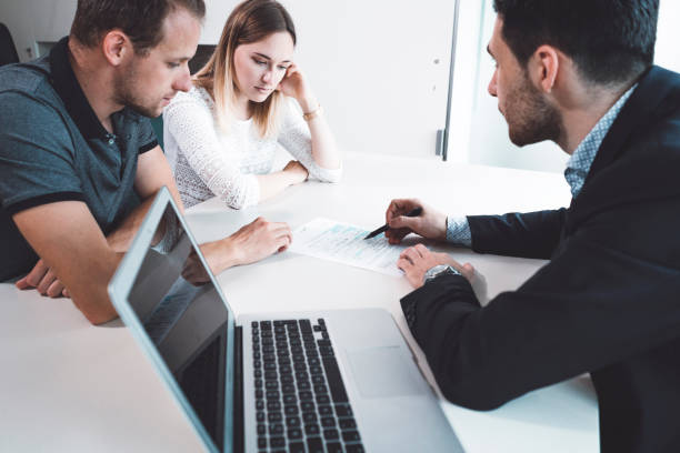 Unhappy young couple at meeting with lawyer about divorce stock photo