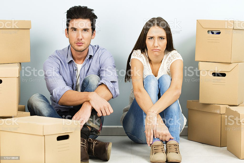 Unhappy young couple moving house royalty-free stock photo