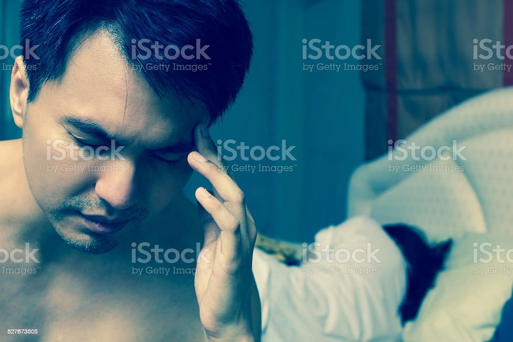 Unhappy young couple with problem in bedroom stock photo