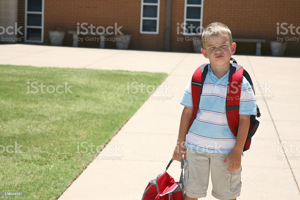 Unhappy Young Student at School royalty-free stock photo