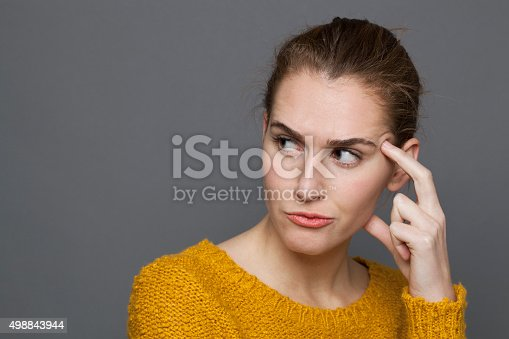 istock unhappy young woman looking dubious,expressing confusion and mistrust 498843944