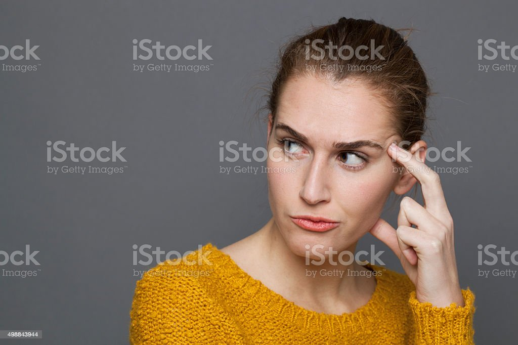 unhappy young woman looking dubious,expressing confusion and mistrust stock photo