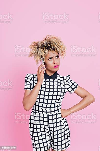Unhappy Young Woman On Her Phone Stock Photo - Download Image Now