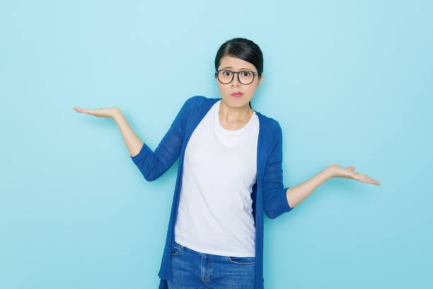 unhappy young woman showing choosing posing stock photo