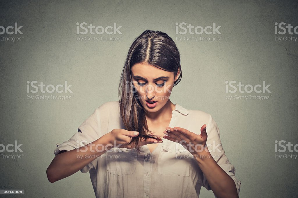 unhappy young woman surprised she is losing hair stock photo