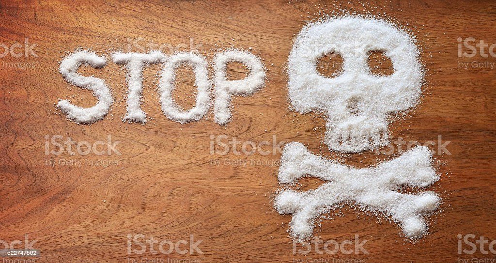 Unhealthy concept. White sugar objects on brown background. stock photo
