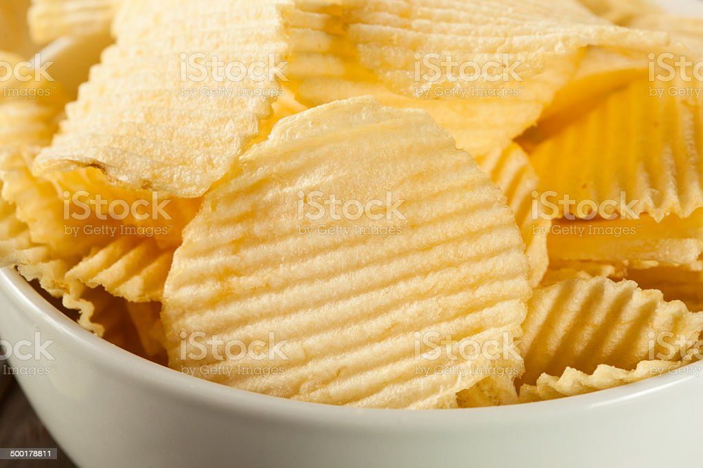 Unhealthy Crinkle Cut Potato Chips stock photo