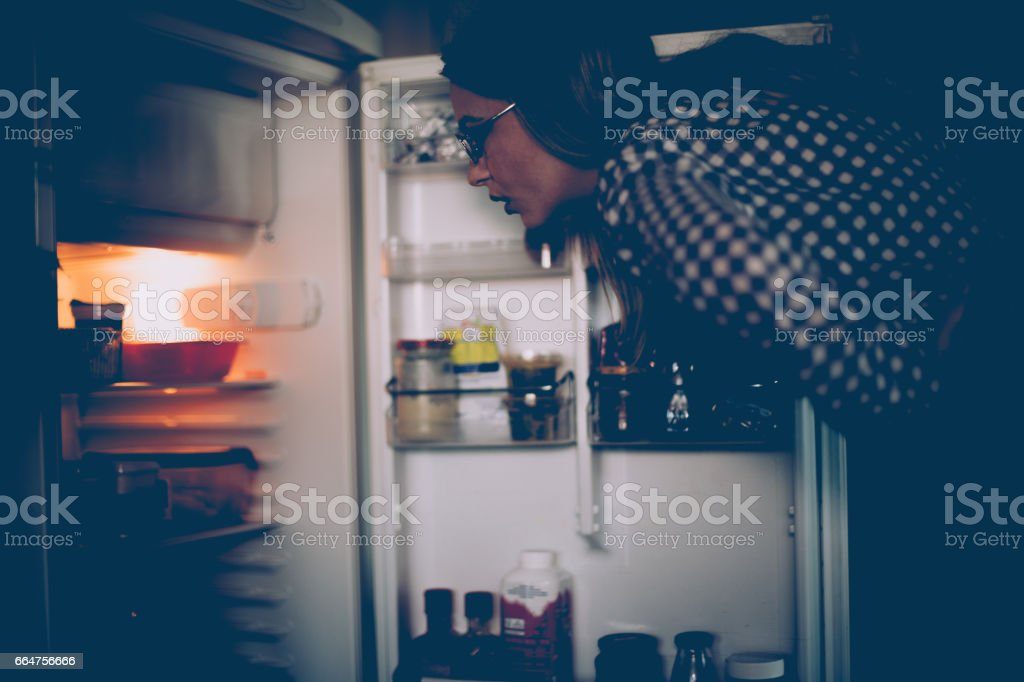 Unhealthy eating in the night hours stock photo