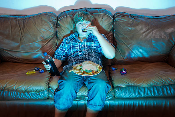 unhealthy eating - laziness stock photos and pictures