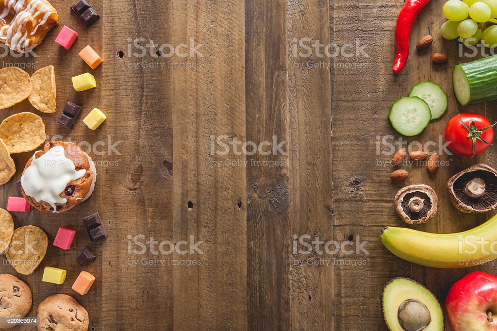 Unhealthy food and healthy food stock photo