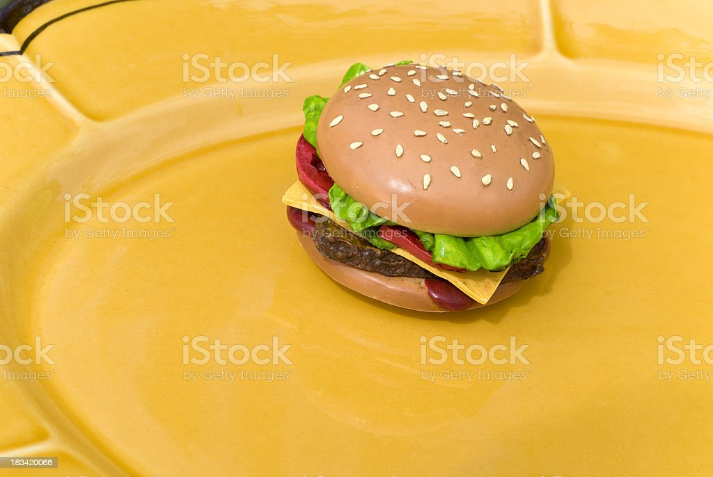 Unhealthy Food Eating: Artificial, Fake Burger, Plastic Cheeseburger Lunch stock photo