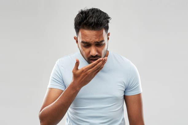 unhealthy indian man coughing stock photo