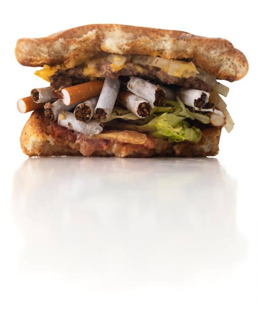 Unhealthy Lifestyle - Cigarette Burger stock photo